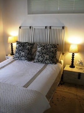 Bedroom with double bed and en-suite bathroom with shower