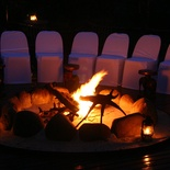 Our guests enjoy pre-dinner drinks around fire