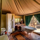 Luxury tent bathroom, with bath and outside canvas shower